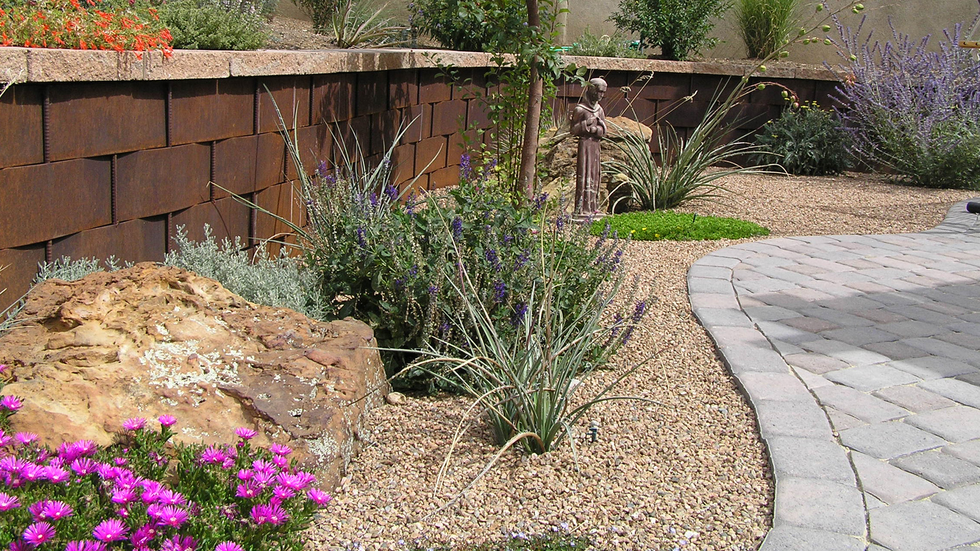 Gecko Landscaping Inc. Hardscaping, Stone Patios and Outdoor Kitchens slide 1